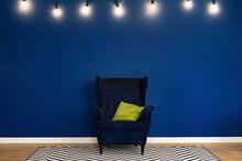 Dark Blue Arm-chair Against Bl...