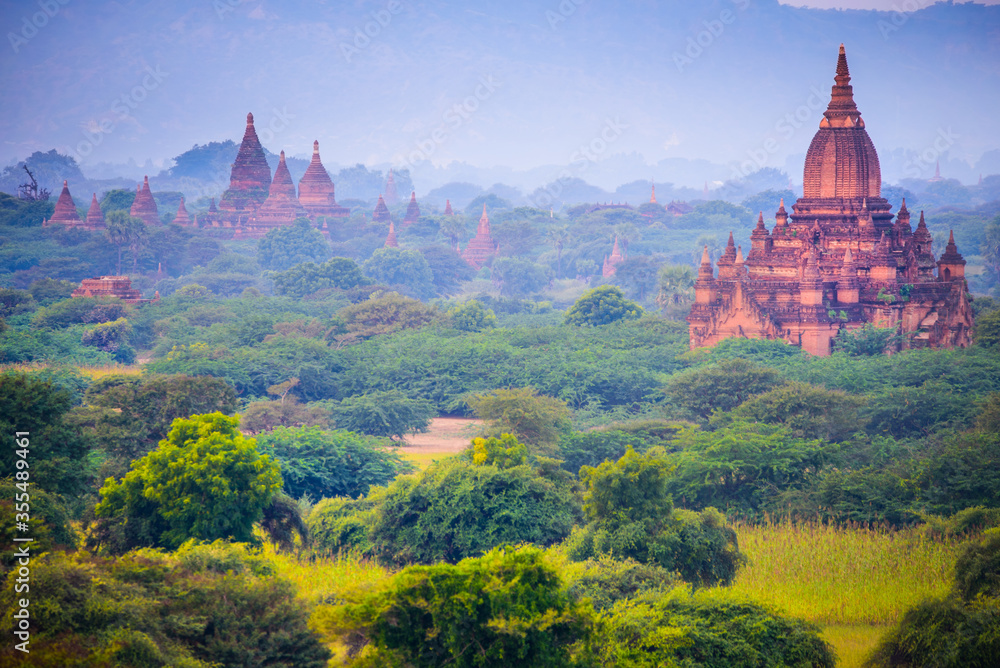 View of a Majestic Ancient Pagoda inside a Forest in Bagan, Myanmar. Beautiful Morning Time, Copy Space