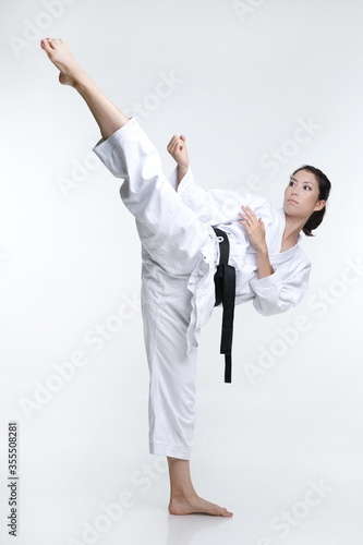 Obrazy Karate   black-belt-martial-artist-woman-doing-a-high-kick-in-her-karate-clothes
