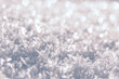 Snow winter background with snow texture closeup. Snow cristals macro. Wonderful winter holiday background. Christmas concept