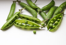 Green Pea Pods On A Light Back...