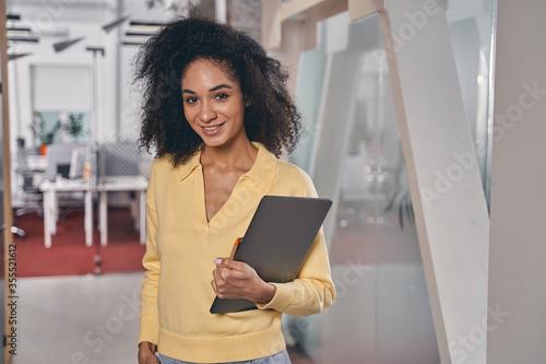 Fotografia, Obraz Smiling attractive woman standing in the corridor