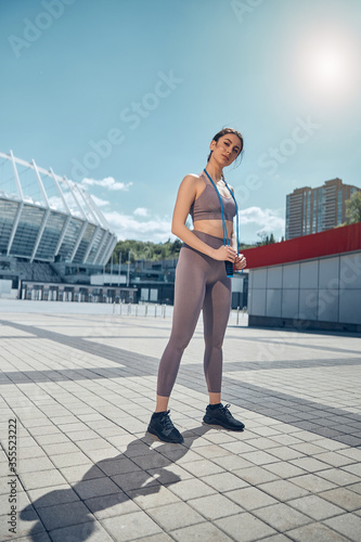 Fotografia, Obraz Calm athletic lady with a jump rope