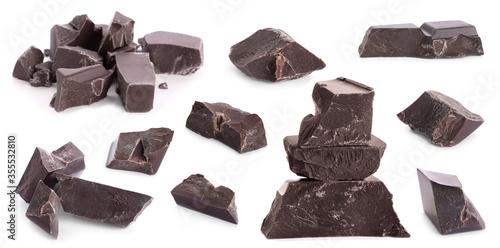 Fotografija Set with delicious dark chocolate chunks on white background