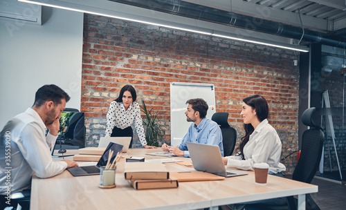 Managers discussing presentation of business project with boss in office Canvas Print