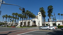 Union Station In Downtown Los Angeles With Palm Trees And Blue Sky