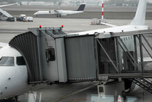 Plane On Airport Connected To Gate Sleeve. Aircraft And Sleeve. Gate At The Airport For Passengers To Plane Boarding.