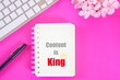 Leinwandbild Motiv content is king word on notebook with laptop keyboard,pen flat lay on pink background ,business plan concept