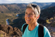 Senior Woman Hiker Wearing A B...
