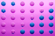 canvas print picture - 3d monochrome pink and blue  illustration: a row of winged balls  with many faces polygones. Simple geometric shapes in a row.