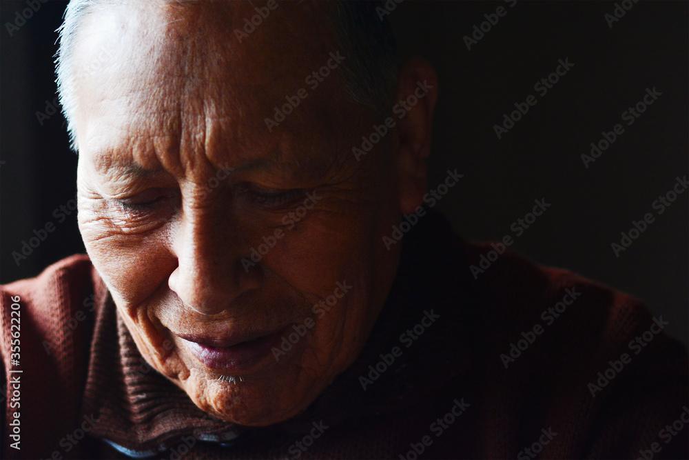 Fototapeta Smiling old age native american man.