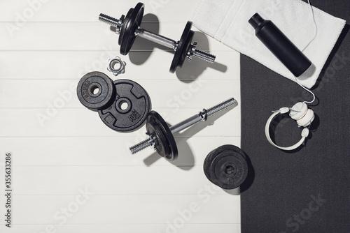 Fototapeta Sport equipment on white wooden background, training at home concept. obraz na płótnie