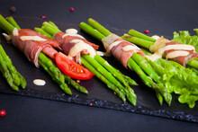 Bacon Asparagus Bundles Served On A Blackstone Board