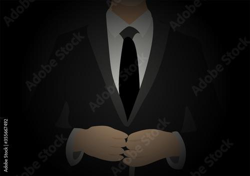 Fototapeta Hombre con traje y corbata en oscuridad.