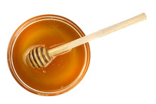 Honey In A Bowl With A Wooden ...