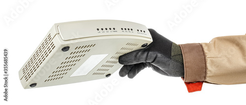 Hand of IT-specialist in black protective glove and brown uniform holding VoIP g Wallpaper Mural