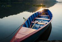 A Blue Wooden Boat Parked On T...