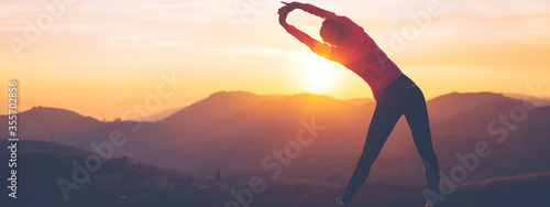 Athletic girl doing stretching after the evening jog Canvas Print