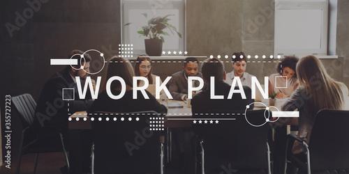 Plakat do biura  work-plan-written-on-group-of-people-discussing-work