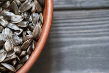 Sunflower Seeds In Plate On Wo...