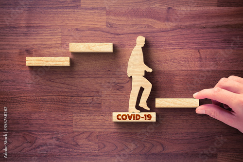 Post covid-19 era helping hand for business and economy concept Canvas Print