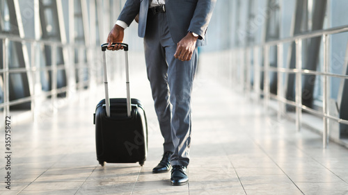 Unrecognizable Business Guy Walking With Suitcase In Airport Terminal Fotobehang