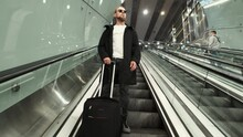 A Man With Baggage Goes Down E...