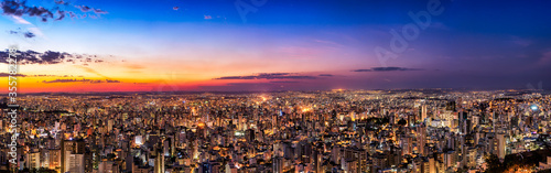 Fototapeta Panoramic Night Cityscape View During Dusk Sunset From Water Tank Lookout in Bel