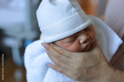Fototapeta mother parenting, mom using hand help a baby newborn belch burping after breastf