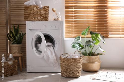 Obraz Stylish room interior with washing machine. Design idea - fototapety do salonu