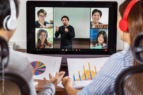 Rear view of Asian partner working and online meeting via video conference with Fototapet