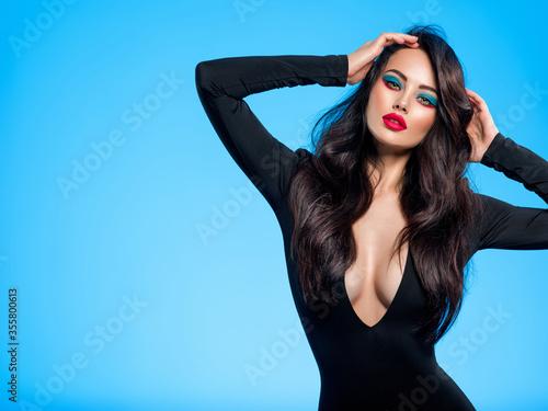 Fényképezés Portrait of beautiful young woman with bright blue makeup