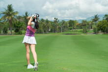 Lady Golfer Are Finished Golf Swing On Golf Course.