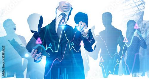 Fényképezés Man using financial graph interface in city, team