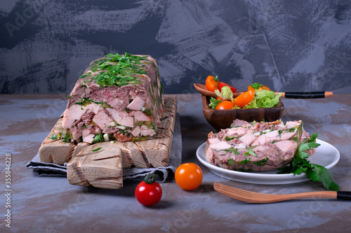 Pork and beef terrine with herbs served with tomato salad Wallpaper Mural