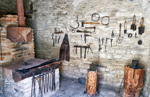 Valokuva The wall exhibition of blacksmith craft work