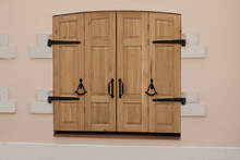 Wooden Oak Swing Doors In The Old Style. Vintage Wrought Iron Handles And Hinges