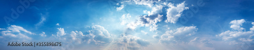 Obraz Panorama sky with beautiful cloud on a sunny day. Panoramic high resolution image. - fototapety do salonu