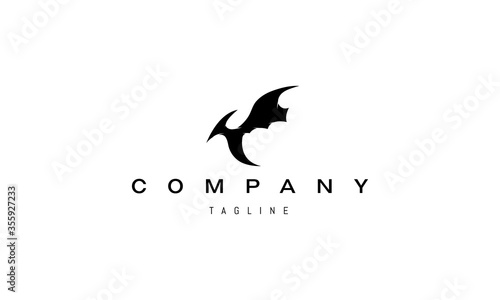 Obraz na plátně Vector logo on which an abstract image of a flying pterodactyl.