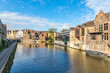 canvas print picture - Downtown brick houses, river and moored boat Ghent, Belgium