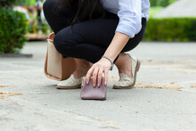 Woman  And A Wallet  On The Ground
