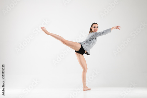 Female dancer in a classical ballet dance poses on a white background Wallpaper Mural