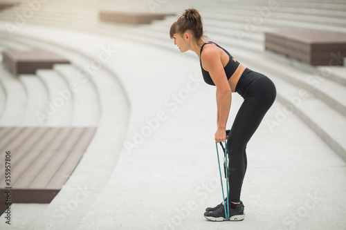 Fotografie, Obraz beautiful young woman with a sports figure is engaged in training outdoors