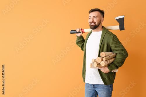 Fototapeta Handsome lumberjack on color background obraz