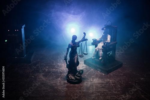 Foto Death penalty electric chair miniature on dark