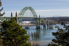 Yaquina Bay Bridge In Oregon. Opened In 1936 On Route 101 Coast Highway This Stylized Arch Bridge Passes Over Yaquina Bay In Newport, Oregon
