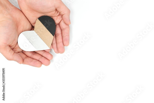 Fototapeta Male hands holding multicolored heart shape. Support All Lives Matter movement, stop racism and  racial equality concept. obraz