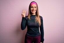 Young Blonde Fitness Woman Wearing Sport Workout Clothes Over Isolated Background Showing And Pointing Up With Fingers Number Three While Smiling Confident And Happy.