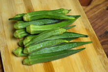 Lady Fingers Or Okra Vegetable Over Wooden Table Background
