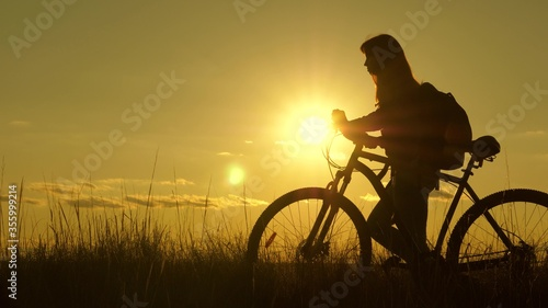 Fotografie, Obraz woman cyclist overcomes an obstacle
